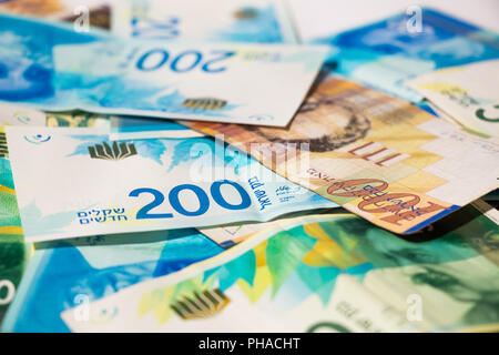 Stack of various of israeli shekel money bills - Stock Photo