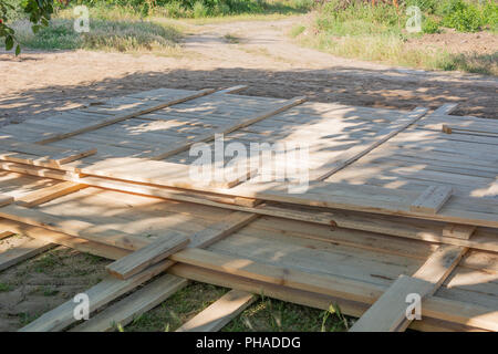Wooden formworks fence. Formwork for foundation wooden fence. - Stock Photo