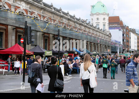 People outside food stalls on Long Lane at the Smithfield 150 Street Party 25 August 2018  in London England UK  KATHY DEWITT - Stock Photo