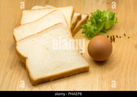 Pile of sliced bread, egg and vegetable - Stock Photo