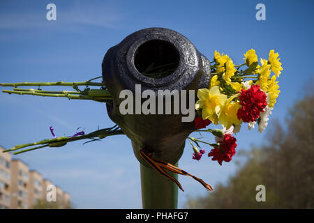 Beautifrul flowers in the barrel of the tank. May 9th. Victory day in Russia. Peace in the world. Memorial day - Stock Photo
