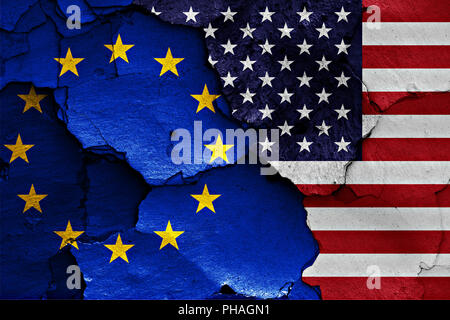 flags of EU and USA painted on cracked wall - Stock Photo