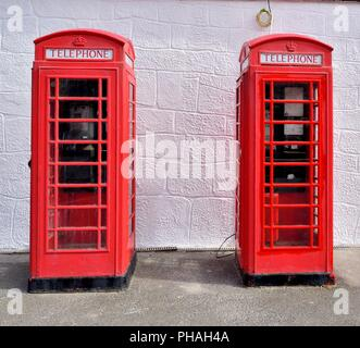 Two British traditional red telephone boxes at Lands end,Cornwall,England,UK - Stock Photo