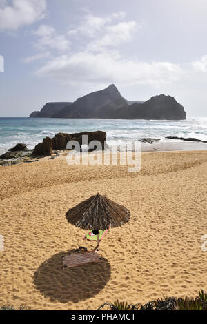 Ponta da Calheta beach and the Cal islet (Ilhéu da Cal). Porto Santo island, Madeira. Portugal - Stock Photo