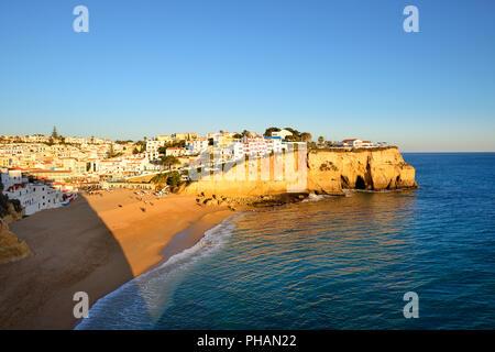 The beach and village of Carvoeiro. Lagoa, Algarve, Portugal - Stock Photo