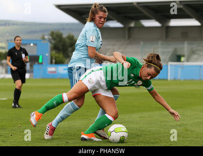 Republic of Ireland's Katie McCabe and Northern Ireland's Bellie Simpson during the FIFA Women's World Cup qualifying, group 3 match at the Tallaght Stadium, Dublin. - Stock Photo