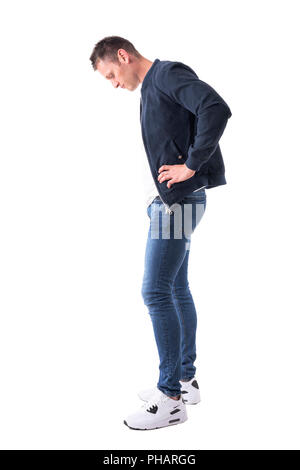 Side view of sad casual adult man in bomber jacket looking down at sneakers. Full body isolated on white background. - Stock Photo