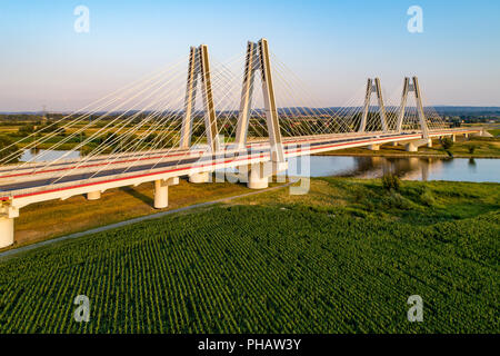 New modern double cable-stayed bridge over Vistula River in Krakow, Poland. Part of the ring motorway around Krakow under construction. Aerial view at - Stock Photo