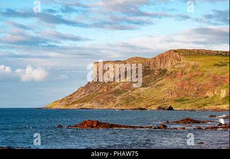 Famous Fair Head cliff on the Northern coast of County Antrim, Northern Ireland, UK. - Stock Photo
