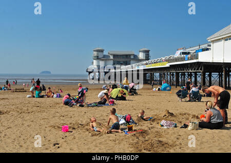 UK Weather. Record numbers of Visitors to Weston Super Mare up due to the Hot Weather this year. Pictures show this afternoon friday the 31st last day of August people enjoying the very hot summers sun , beach relaxing, children on the world famous Donkey rides and walking along the promenade front. Robert Timoney/Alamy/live/News - Stock Photo