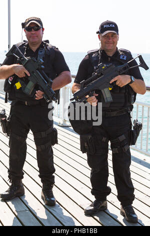 Bournemouth, UK. 31st August 2018. Crowds flock to Bournemouth for the 2nd day of the 11th annual Bournemouth Air Festival. Armed police on patrol. Credit: Carolyn Jenkins/Alamy Live News - Stock Photo