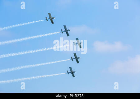 Bournemouth, UK. 31st August 2018. Crowds flock to Bournemouth for the 2nd day of the 11th annual Bournemouth Air Festival.  Team Raven thrill the crowds. Team Raven, aerobatic display team of 5 aircraft display for the first time at Bournemouth. Credit: Carolyn Jenkins/Alamy Live News - Stock Photo