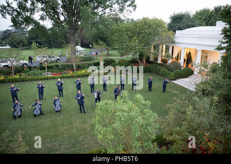 Members of the United States Air Force Band perform for guests during the White House Historical Association Presidential Sites Summit Reception on Wednesday evening, August 29, 2018, in the Rose Garden of the White House  People:  President Donald Trump - Stock Photo