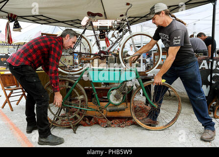 Davenport, Iowa, USA. 31st Aug, 2018. Mike Wolfe, left of Antique Archaeology in Le Claire, Iowa gets help from Jon Szalay of Barnegat, New Jersey while setting his 1902 Royal motorcycle next to Szalay's 1901 Thomas motorcycle at the Chief Blackhawk 47th Davenport Fall International Antique Motorcycle Swap Meet at the Mississippi Valley Fair Grounds Friday, August 31, 2018. The 1901 Thomas is considered to be the first production motorcycles in the United States both bikes were produced in New York State. The meet runs through Saturday. (Credit Image: © Kevin E. Schmidt/Quad-City Times/Q - Stock Photo