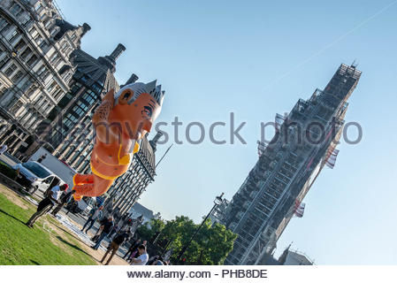London, UK. 1st September 2018. A blimp of Sadiq Khan wearing a yellow bikini flew over Westminster on Saturday morning. The event is a  response to the Donald Trump baby balloon that the London mayor permitted in July.  Credit: David Nash/Alamy Live News - Stock Photo