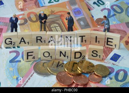 Symbolfoto Wirtschaftsbegriff Garantiefonds - Stock Photo