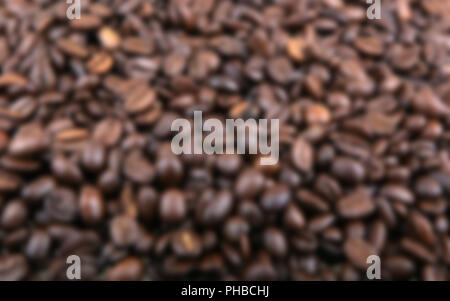 Blurred abstract background of coffee beans - Stock Photo
