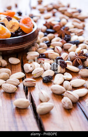 Mix of dried fruits and nuts in backlit - Stock Photo