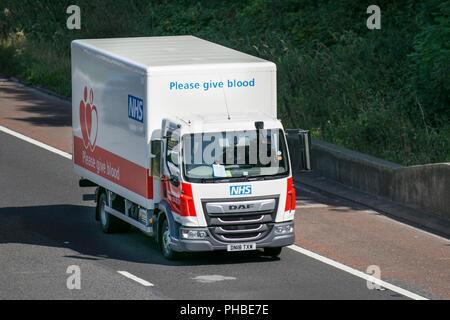 NHS  Blood Transfusion vehicle, DAF LF on the M6; Heavy Haulage, Lancaster, UK - Stock Photo