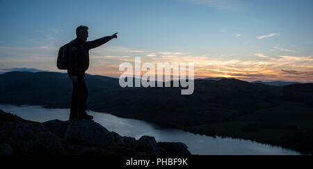 Looking over Ullswater from the summit of Hallin Fell at sunset, Lake District National Park, UNESCO, Cumbria, England, United Kingdom - Stock Photo