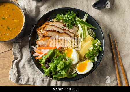 Homemade No Broth Mazemen Ramen with Pork Belly and Veggies - Stock Photo