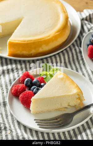 Homemade New York Cheesecake with Berries and Mint - Stock Photo