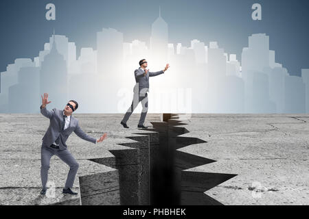 Blindfolded businessman in uncertainty concept - Stock Photo
