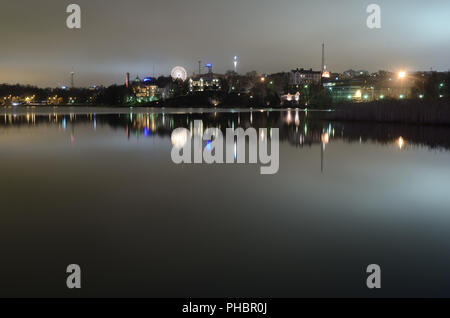 night Helsinki, the reflection in the water, Finland - Stock Photo