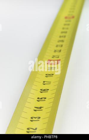 Yellow metal industrial tape measure - Stock Photo