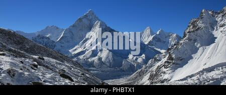 Mount Ama Dablam and other snow covered mountains - Stock Photo