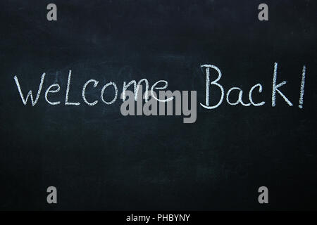 Words written in chalk on blackboard - Stock Photo