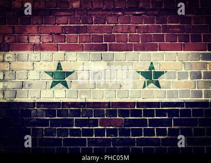 Grunge Syria flag on a brick wall - Stock Photo