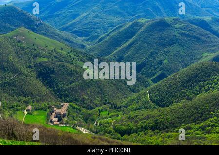 Aerial view of Fonte Avellana Monastery, Mount Catria, Umbria, Italy, Europe - Stock Photo