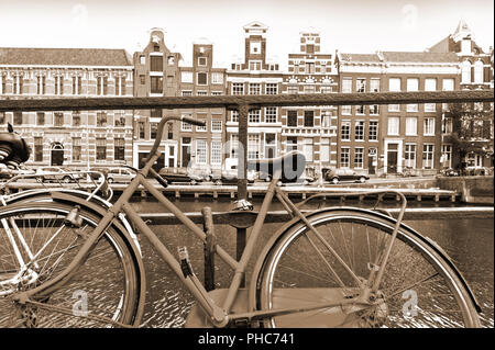 Bike Parked on an Embankment in Amsterdam - Stock Photo
