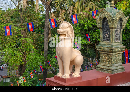 Phnom Penh, Cambodia - April 8, 2018: A guardian lion statue or leogryph in front of the main stupa of Wat Phnom (Mountain Pagoda) - Stock Photo