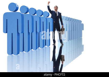 Standing out from crowd concept with businessman - Stock Photo