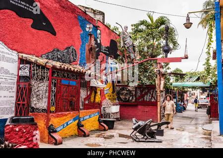 Havana, Cuba / March 20, 2016: Tucked in a hidden corner of Old Havana, Callejón de Hamel (Hamel's Alley) brings Afro-Cuban to colorful life.