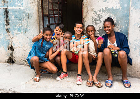 Diverse group of kids eagerly awaiting President Obama's historic visit to Cuba are excited and happy to see Americans in Old Havana. - Stock Photo