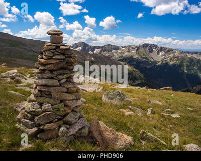 Large Rock Cairn on Mountain Summit Meadow, Continental Divide Trail, Rocky Mountain National Park, Colorado - Stock Photo