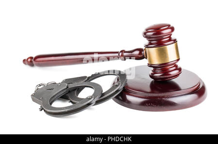 Gavel and handcuffs on white background - Stock Photo