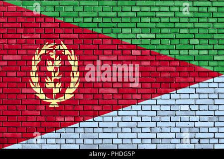 flag of Eritrea painted on brick wall - Stock Photo