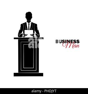 Businessman, Manager. A man in a business suit. Businessman reading the report on the podium - Stock Photo