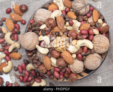 Assorted nuts in bowl - Stock Photo