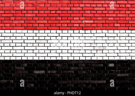 flag of Yemen painted on brick wall - Stock Photo