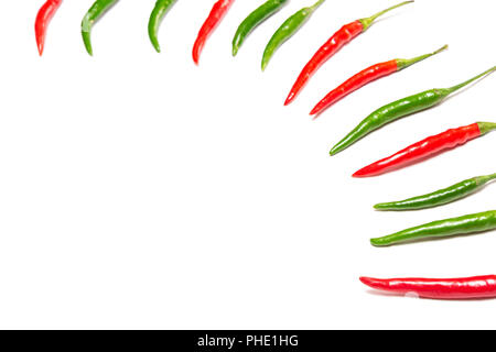 Red and green chili peppers on white background. Selective focus, copy space - Stock Photo