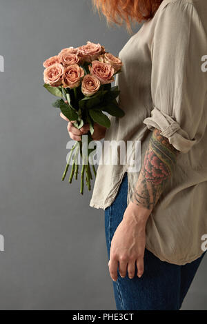 Girl holds a bouquet of beige roses cappuccino - Stock Photo