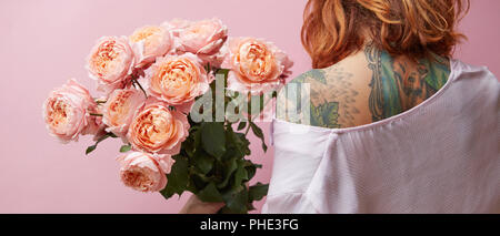 Woman with a big bouquet of pink Buttercup Asian - Stock Photo