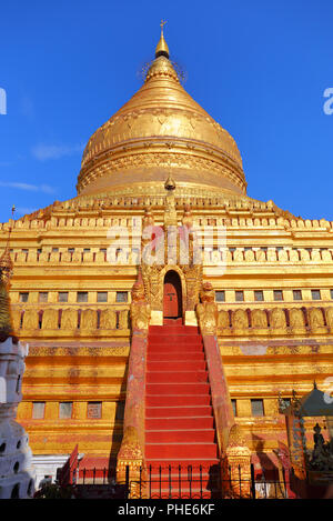Golden Shwezigon Pagoda in Bagan Myanmar - Stock Photo