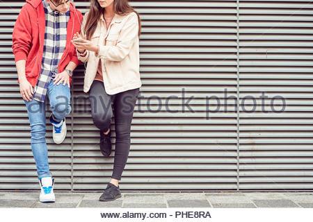 Teenage couple sharing music - Stock Photo