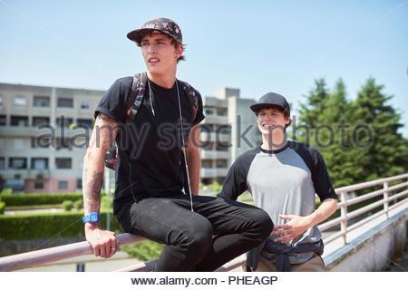 Teenage boys wearing baseball caps - Stock Photo